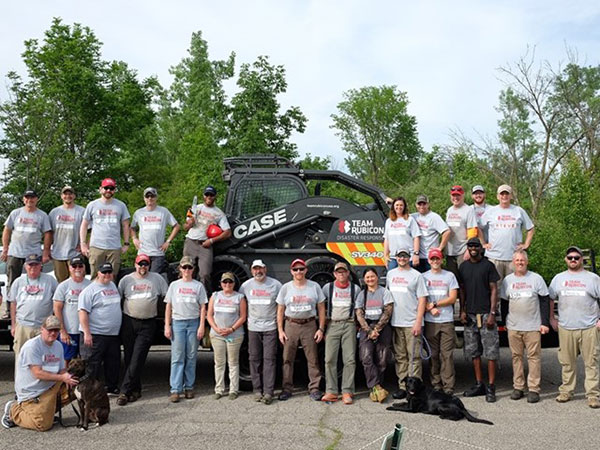 Team Rubicon members assist in cleaning up the aftermath of tornadoes in Dayton, Ohio. (Photo: Case Construction Equipment)