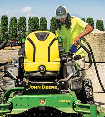 Crew member fueling up mower (Photo: Tony Ventouris)