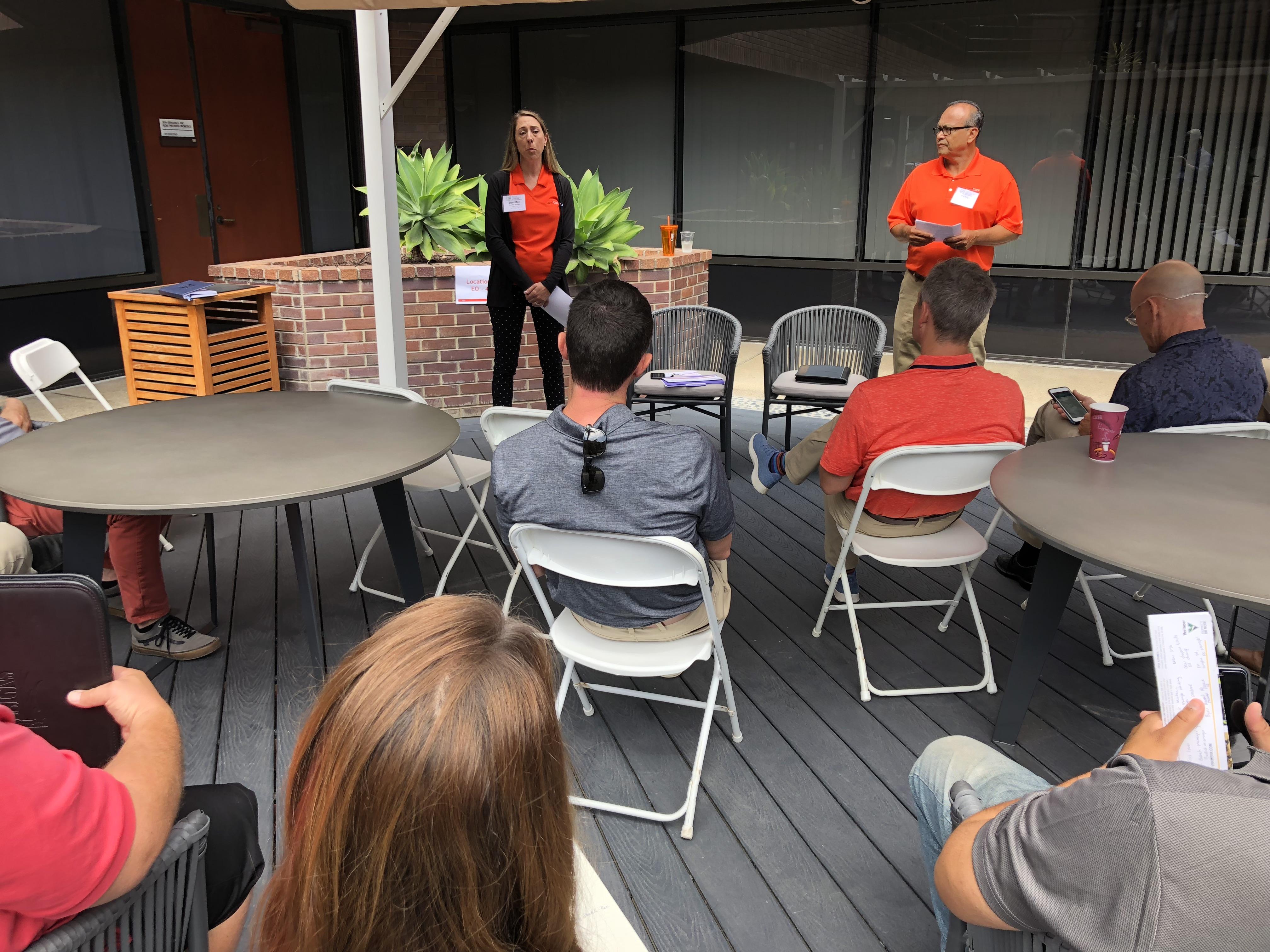 Jennifer Burnett and Ramon Ulloa discuss training and development of LandCare's employees. (Photo: Seth Jones)
