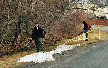 Sometimes, JC Grounds Management starts spring cleanups despite slight snow cover. (Photo: JC Grounds Management)