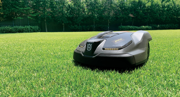 LABOR SAVER Installing robotic mowers on residential properties can help cut down on man-hours. Photo: Husqvarna