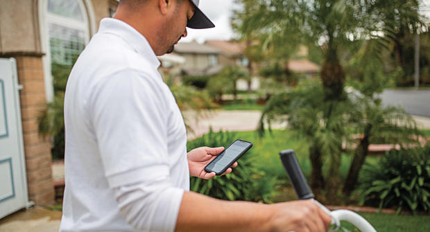 STAY ON TRACK Using software can help landscapers be more professional and effective with clients. Photo: Jobber