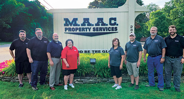 Schlutt, pictured on the far right, says the company values second chances. (Photo: MAAC Property Services)
