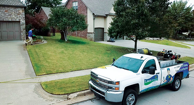 LawnAmerica truck and spray operator (Photo: Chris Seagraves)