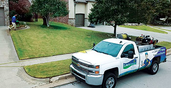 Lawn care truck and spray operator (Photo: Chris Seagraves)