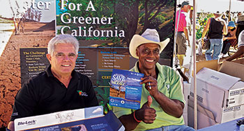 Ed Wallace was the first African American president of the Orange County chapter of the California Landscape Contractors Association. Wallace and fellow contractor, Richard Cohen, man a CLCA booth. (Photo: Ed Wallace)