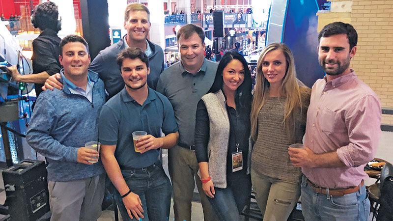 Nothing but a good time Left to right, Payton Turner, SingleOps; Lanier Milner, SingleOps (behind); Alex Smith, SingleOps (front); Casey Hurd, Greenscapes Land Care; LM's Chloe Scoular; Emily Traxler, SingleOps; and Sean McCormick, SingleOps. Photo: LM Staff