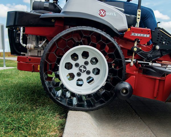 MORE MOW TIME Airless radial tires help eliminate downtime on mowers and reduce many maintenance costs. (Photo: Exmark)