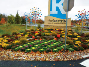 Wagner Landscaping tends to the Kartrite Resort & Indoor Waterpark's outdoor property as well. Annuals are planted at the front entrance sign each season, like this display of mums with some pumpkins. (Photo: Steven Wagner)