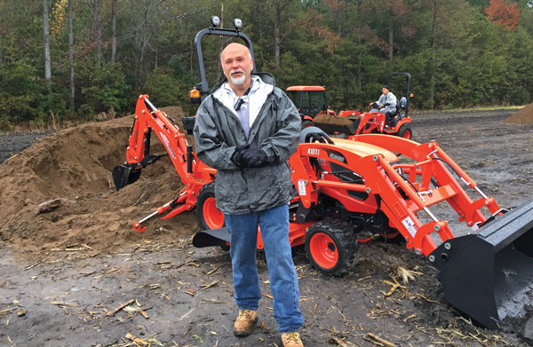 Giving the lowdown Despite the chilly, rainy day, Ron Morgan, territory manager at Kioti Tractor, provides information on the new developments within Kioti's tractor lineup during the Kioti Ride & Drive dealer event near Raleigh, N.C., on Nov. 12. (Photo: Sarah Webb)