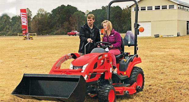Kioti's Greg Bibee gives LM's Sarah Webb the rundown on Kioti's CS2210 tractor. (Photo: Kioti)