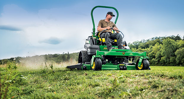 Man riding zero-turn mower (Photo: John Deere)