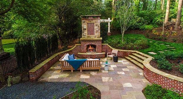 Custom stone and brick fireplace (Photo: Joel Hordyk, Cameron Street Photography)