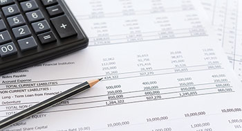 Tax papers and calculator (Photo: utah778/iStock / Getty Images Plus/Getty Images)