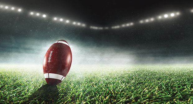 Football in stadium (Photo: Marcus Millo/iStock / Getty Images Plus/Getty Images)