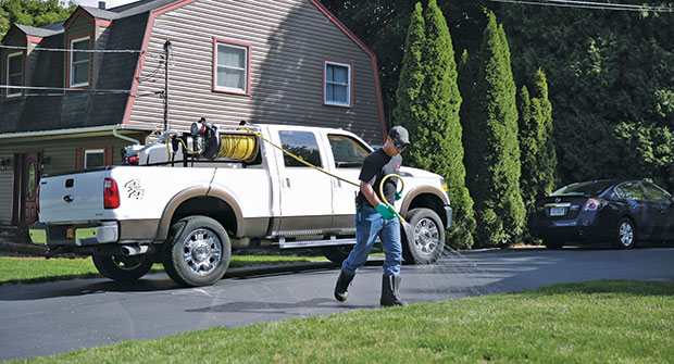Lawn care operator spraying a lawn (Photo: Gregson-Clark Spraying Equipment)