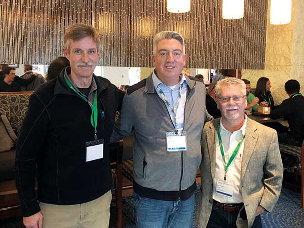 Envisor Consulting's Ben Gandy (left) and Ken Thomas with Seth Jones (middle). (Photo: LM Staff)