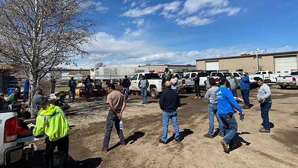 Longs Peak employees hold a meeting while practicing social distancing. (Photo: Mike DePriest)