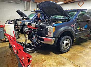 Mechanic performing fleet maintenance (Photo: J. Barker Landscaping Co.)