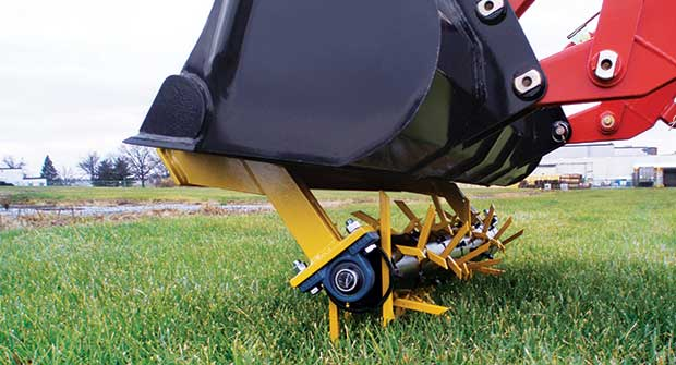 Aerator tines in action (Photo: Earth & Turf)