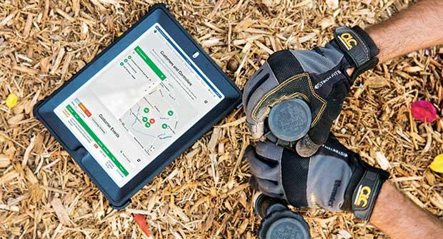 Irrigation tech adjusting fixtures (Photo: Hunter Industries)