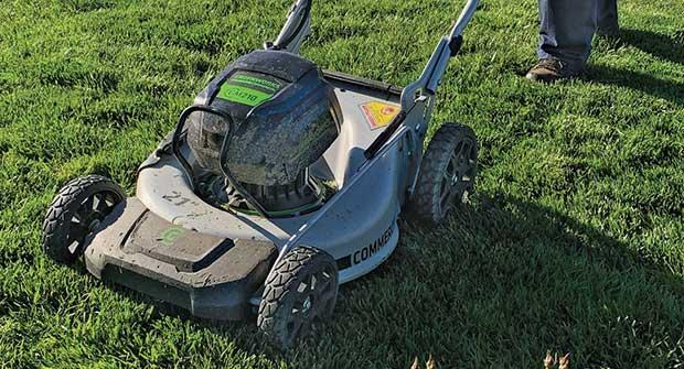 Crew member mowing (Photo: Phoenix Landscape Management)
