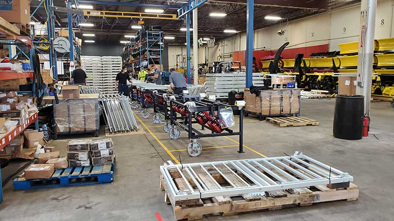 Putting snow plow assembly on hold, SnowPlow's warehouse aisles were converted to storage bays for the large quantity of hospital bed components. (Photo: SnowWolf)