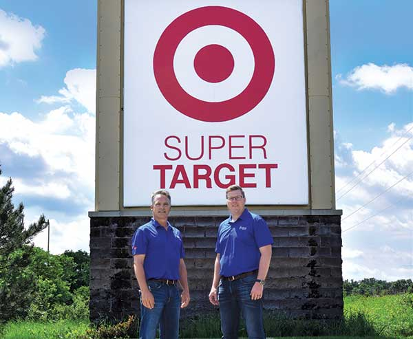 Conserva employees in front of Target Superstore sign (Photo: Conserva Irrigation)
