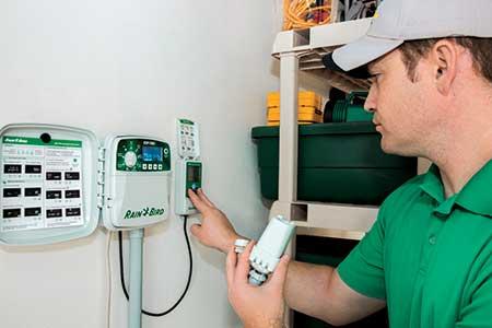 Tech programming a controller (Photo: Rain Bird Corp.)
