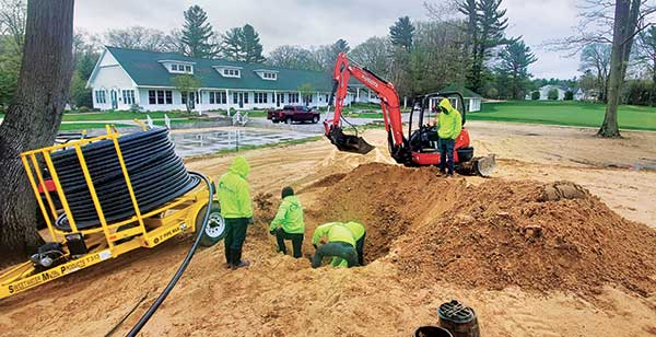 Crews performing golf course irrigation service (Photo: Winterberry Gardens)
