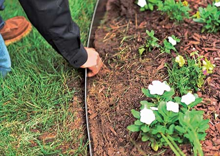 Checking landscape edging (Photo: Coyote Landscape Products)