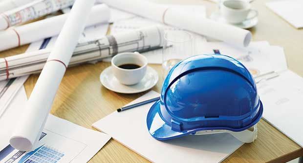 Hardhat and construction plans (Photo: Chris Ryan/OJO Images/Getty Images)