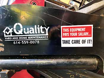 Sign on piece of equipment (Photo: Quality Yard and Home Maintenance)