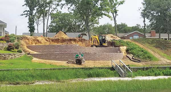 Compact excavator at work (Photo: ProGreen Turf and Landscape)