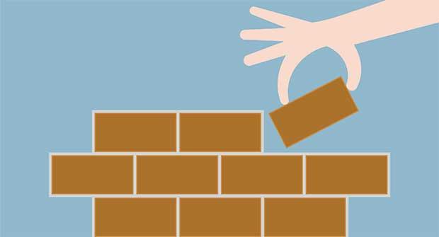 Laying brick foundation (Photo: lekkyjustdoit / iStock / Getty Images Plus)