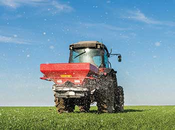 Spreading enhanced-efficiency fertilizers (Photo: fotokostic/iStock / Getty Images Plus/Getty Images)