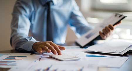 Person doing finances (Photo: ridvan_celik/E+/Getty Images)