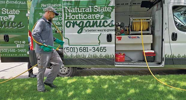 Person spraying lawn (Photo: Natural State Horticare)