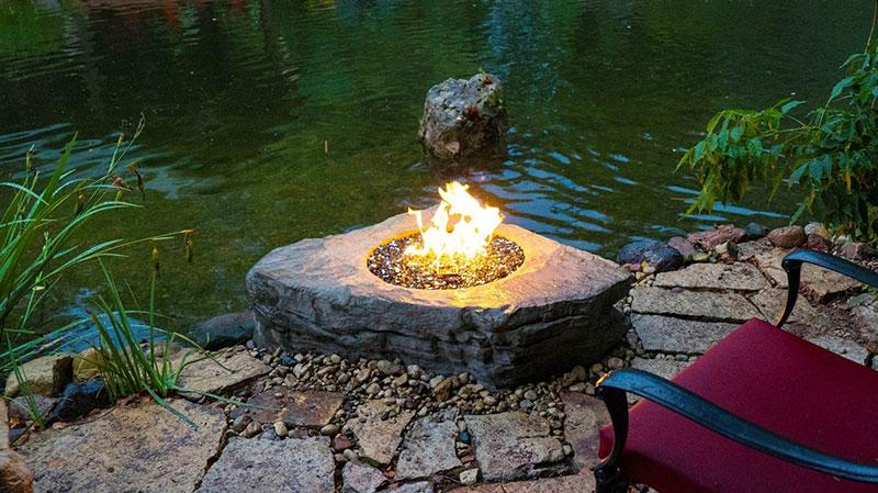 Aquascape's Faux Stone Fire Pit is constructed of glass fiber reinforced concrete. (Photo: Aquascape)