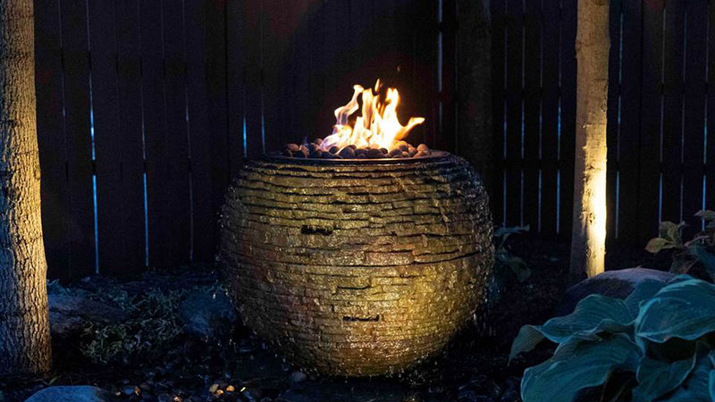the Fire and Water Stacked Slate Sphere takes an existing Aquascape decorative fountain and merges it with the company's fire system. (Photo: Aquascape)