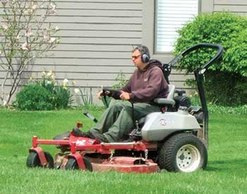 Crew member mowing (Photo: Twin Oaks Landscape)
