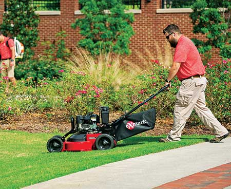 Person using Exmark mower (Photo: Exmark)