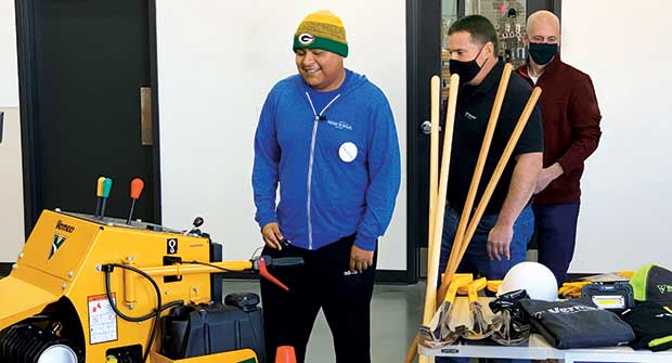 Edgar Contreras (left) is presented with his new equipment by Bear Reynolds of Vermeer and Chris Brouwers with KS Energy. (Photo: Vermeer)
