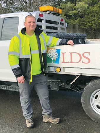 Tim Koehler in front of LDS truck (Photo: Landscape Design Services)