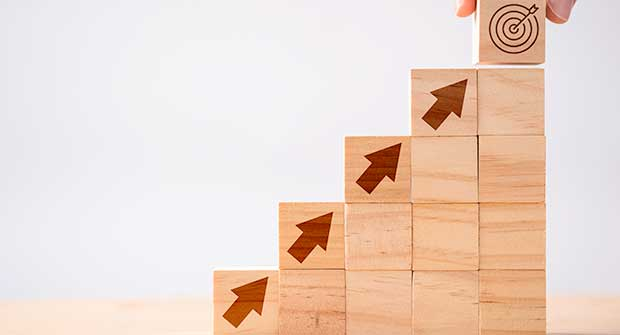 Upward building block toward target (Photo: Dilok Klaisataporn / iStock / Getty Images / Getty Images Plus)