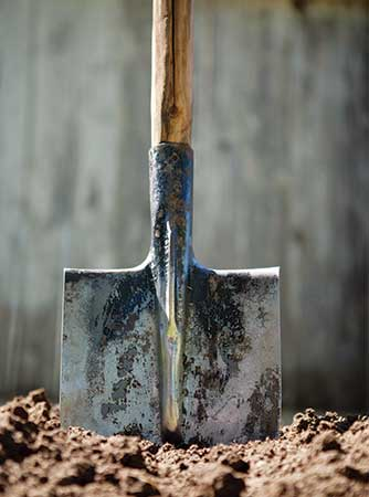 Shovel in dirt (Photo: onecooltree/iStock / Getty Images Plus/Getty Images)