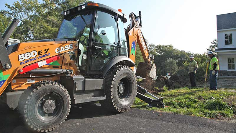 A crew with National Grid uses the Case 580 EV backhoes from Case Construction Equipment. The backhoes require no diesel and produce zero emissions. (Photo: Case Construction Equipment)