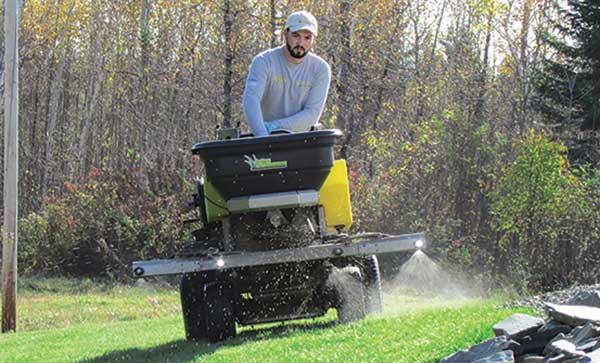 Person spreading fertilizer (Photo courtesy of Patrick Vaillancourt)