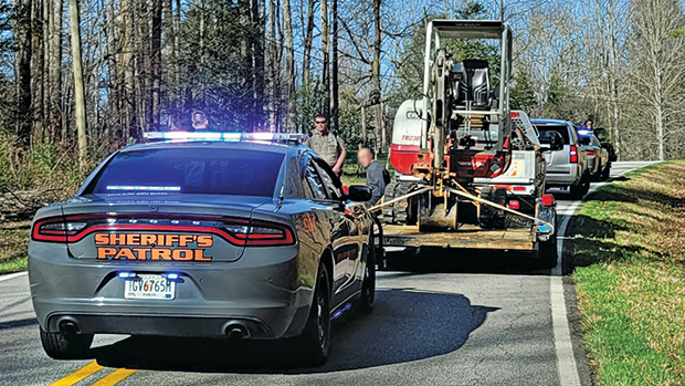 Police apprehend the suspect who stole a mini excavator from one of LDC Groups' job sites in Lula, Ga. (Photo courtesy of LDC Groups)