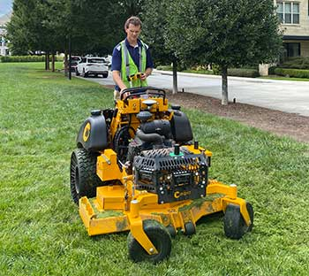 Person setting boundary on robotic mower (Photo: Greenzie)